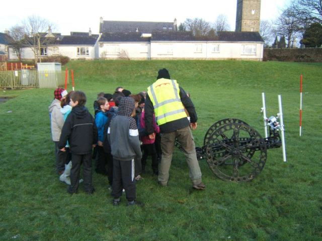 The pupils of St. Ninian's Primary School are shown how the Rubicon geophysics cart operates